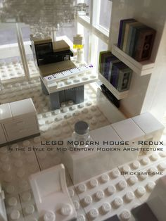 """LEGO Modern House - Redux - in the Style of Mid-Century Modern Architecture by Bricksare4me - as seen at BrickCan 2016 in Vancouver BC - awarded """"Best Edifice"""" - craft room / office with drafting table and bookshelves"""