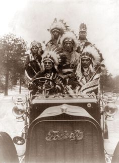 a group of Indians riding in a Toledo Automobile. The picture was taken in 1905. Not clear if they were part of a Wild West show.