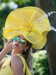 Ester Dohnalova poses for a photograph, on the first day of the Royal Ascot horse racing meeting, in Ascot, England, Tuesday, June 17, 2014....