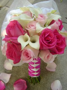 Bridal bouquet featuring calla lillies, light and hot pink roses accented with crystalsvendors: empora Floral Artistry
