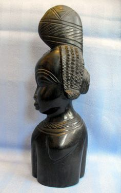 B6936 £SOLD (March 2015). A vintage solid ebony or similar flat back figural wall plaque of the side view, torso and head, of an African female.