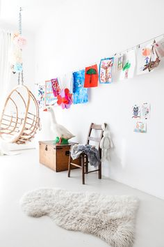 Bright, white child's room with hanging artwork
