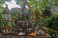 Another view of the Potting Bench inspiration from Octoberfarm. I have a couple bird cages in Mom's attic for this!