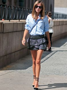 Day 5 of #nyfw #ss2013 #rtw - Marina Larroude ALWAYS looks great! love her shoes, love the crisp button down paired with the flirty mini ruffled skirt!