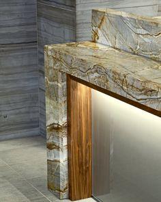 Combination of natural stone & black walnut accent this reception desk at the Hyatt Regency Maui Resort & Spa.