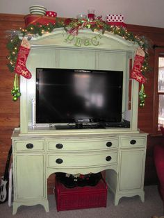 Love the combination of a repurposed buffet with a totally separate hutch!  They were cleaned up, painted and then married together to make a really awesome TV and accessory cabinet!  It is beautiful and fascinating.  I've never seen one like it before! Click through to see its transformation.
