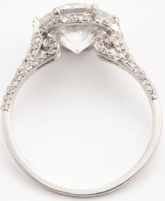 Platinum and Diamond Ring, J.E. Caldwell.    Centered by an old European-cut diamond weighing 2.83 carats, accented by rose and single-cut diamonds weighing approximately 1.00 carat, size 6¼, signed J.E.C & Co., numbered 115219, both the signature and number are partially obscured, two rose-cut diamonds missing, circa 1920. Sotheby's.
