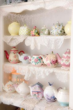Doilies are nice to dress up plain shelves a bit.  Other colors and fabrics might do the same.