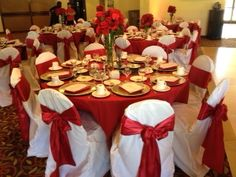 Apple red tablecloths apple red chair sash on a white banquet chair. Pewter Pintuck runner on the tabletop-  #apple red wedding  #Appleredtablecloth  #sandiegowedding