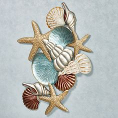 An Ocean Collage of underwater treasures decorates your home with coastal bliss. The textured, dimensional metal wall art sculpture features shells. Metal Tree Wall Art, Metal Art, Nursery Wall Collage, Starfish Wall Decor, Beachy Room, Sea Crafts, Shell Art, Mermaid Birthday, Picture On Wood