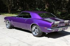 1968 Chevy Camaro in metallic purple. Be still my heart. If I could only buy one car ever. Oh, this would be the one.