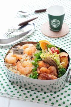 Shrimp pilaf bento box, with sides of sauteed pork & cheese, pan-fried potatoes, bacon & cabbage salad, oranges, and cherry tomato.