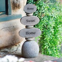 "3-tier cairn stacked with half-cut natural beach/river rocks and flat beach pebbles in between them. ""Home"", ""Sweet"" and ""Home"" are engraved on each rock. Size: Approx. 12"" H Weight: Approx. 10 lbs."