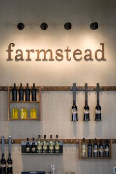 Clean visuals; Farmstead restaurant by EDG Interior Architecture sign close up