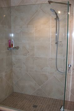 "A true walk-in shower! No doors required. A simple 24"" entrance.  You should see the before picture! It would blow your mind! I'm always one for critiquing my work and I can certainly say that what's missing is body jets and a rain-can from the ceiling. Mind you, my clients were on a budget but they didn't mind the heated floors in the shower...yes, heated floors in the shower. Looking back, I should have convinced them to do the body jets at least.  There's even enough room for 2."