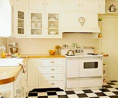Glass & white kitchen cabinets and vintage stove!