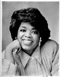 Autographed picture of Oprah wearing my earrings after I went on her show July 2nd, 1986.