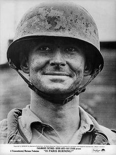Tony Perkins as Sergeant Warren in the film 'Is Paris Burning? Anthony Perkins, Riding Helmets, Paris, Movies
