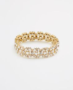 """Our sophisticated wrist-topper sports gorgeous clusters of glittering crystals for a spectacular moment of shine. Hidden stretch. 1/2"""" width."""