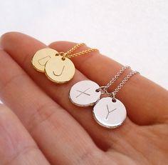 Hand Stamped Initial Disc Necklace The initial necklace is a hand-stamped pendant centered on a delicate chain-link. Compliment her dainty, elegant style with this personalized initial necklace adding a sense of identity and romance. Purchase Delicate initial necklace as a Bridesmaid gift to
