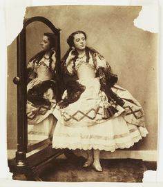 A photograph of a young woman, possibly Isabella Hawarden (b. 1846), taken by Clementina, Lady Hawarden, in about 1863.  During 1863 and 1864, Lady Hawarden photographed her eldest daughters in a series of costumed tableaux staged at their home in South Kensington, London.