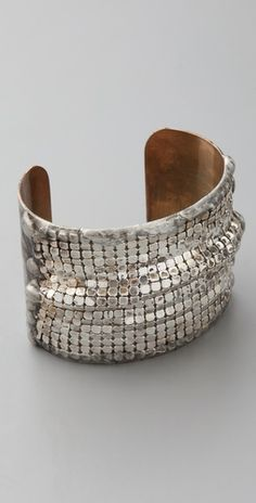 metal-mesh overlay and an oxidized silver-plated finish.