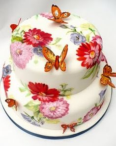 I know this doesn't actually belong here but it has blossoms right? Hand-painted floral cake with butterflies.