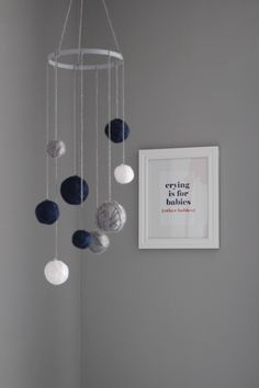 Project Nursery - DIY Mobile with Yarn Wrapped Around Styrofoam Balls