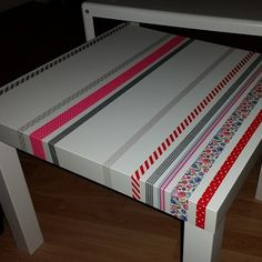 Just a simple IKEA table with some washi tape. =) Easy.