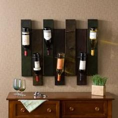 @Overstock - The distressed earth tone finish and durable metal construction highlight this wine rack. The wine rack also holds seven bottles of wine and hangs easily like a picture.http://www.overstock.com/Home-Garden/Nora-7-bottle-Wall-mount-Wine-Rack/5482375/product.html?CID=214117 $76.99