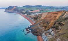 Jurassic Coast cliff collapses in biggest UK rockfall for 60 years | Coastlines | The Guardian The Places Youll Go, Cool Places To Visit, Dorset Beaches, Weathering And Erosion, White Cliffs Of Dover, Dorset Coast, Rock Falls, Jurassic Coast, Slip And Fall