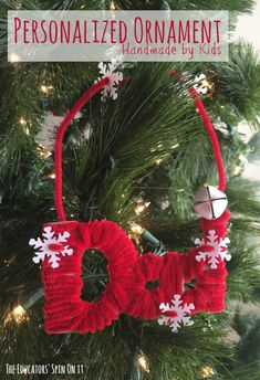 Kids can create a personalized name ornament with just recycled cardboard and pipe cleaners for their Christmas Tree or Gift Tags. Inspired by the book Santa's Book of Names by David McPhail. #ornament #christmas