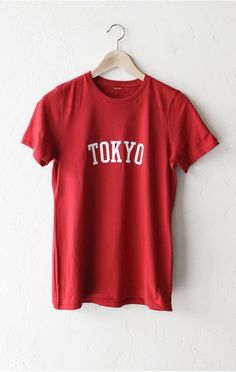 """- Description Details: Organic women's short sleeve t-shirt in red with print featuring 'Tokyo'. Women's Fit/Relaxed. Brand: NYCT Clothing. Measurements: (Size Guide) S: 33"""" bust, 26.5"""" length M: 36"""""""