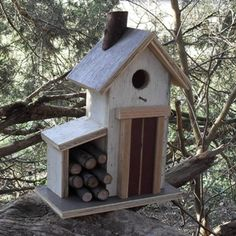 """The Spring Cottage Birdhouse With only a few logs left from Winter, we bring you the Spring Cottage. The perfect model for welcoming your birds back. It stands 13"""" high 12"""" wide and 5"""" deep."""