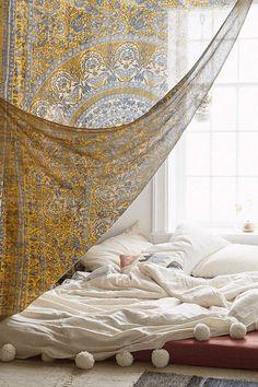 creamy white bedding, benjamin moore cream puff, mustard yellow wall tapestry, platform bed