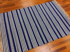 Hand woven rag-rug in cotton. Hand wash at 30 degrees