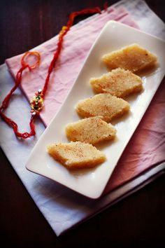 coconut barfi - smooth melt in the mouth fudge made with desiccated coconut and condensed milk. step by step recipe.