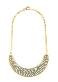 By the Light of the Swoon Necklace in Sky. Your sweetie is picking you up for a night out, so you complete your evening ensemble with this golden, beaded necklace! #blue #modcloth