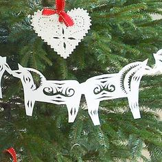 make a Scandinavian horse paper Christmas garland, from the book 'Christmas Crafting in No Time': another great Christmas craft idea, from House Beautiful, on allaboutyou.com. Find 200+ more Christmas craft ideas on allaboutyou.com: magazines online,