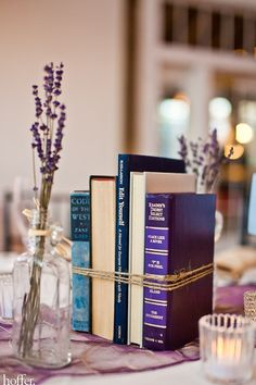 I loved my #centerpieces: vintage books and bottles/vases, lavender, twine, and tea lights I gathered with @Kelly Brewer and @Rachel_Bech. #wedding - Click image to find more Weddings Pinterest pins