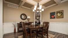 Berkshire Dining Room - Dining room in this Berkshire model features coffered ceilings and wainscotting