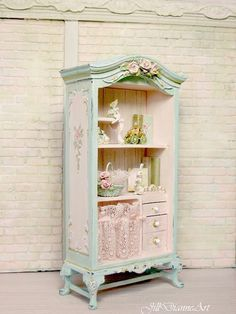 Listing for open cupboard only....rabbit doll and fairy swinging cradle may be available in other listings. As each piece is one-of-a-kind...there may be minor differences. French Cottage chic for any room. Hand-painted and aged Hand-sculpted roses, Pinks, mints and blues - antiqued Antique pink lace Comes with rose basket and perched fairy only. Other tidbits may be available upon request. Ships worldwide Please allow 6 to 8 weeks for shipping from final payment. www.jilldianneart.com