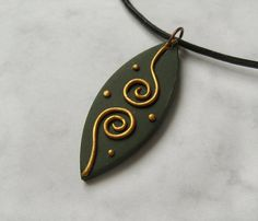 Golden Wishes polymer clay pendant
