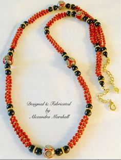 """We love this red Coral, black Hematite, and red, silver, & gold India Art bead rope necklace by Alexandra Marshall. 36"""" - 38"""" long. $179.  reference #N2281 To order double click on the photo."""