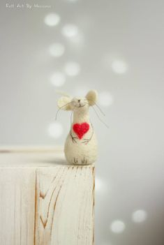 This little needle felted Mouse was born in Sofia a few days ago. He has pink heart and while waiting for his beloved hes sitting on the window. I use felt needle techniques and 100% pure wool form Bulgaria. I dye the wool by my self to achieve the right colors. Size in centimeters: