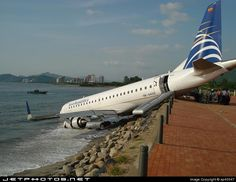 The aircraft [HK-4455] was landing in Santa Marta after a flight from Cali when it skidded off the runway, broke through the perimeter fence, and slid into the sea while landing in heavy rain. Six of the 54 aboard were injured, none seriously.