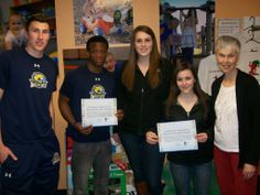 """The Cazenovia College basketball program took some time this morning to read to the children at Cazenovia Children's House as part of their """"March into Reading Program""""."""