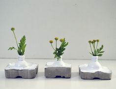 Tiny vases- a little recycling by Studio Krishka cement and old nail polish bottles- these vases are really tiny! http://krishka-studio.blogspot.com