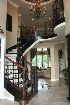 love the entry way - beautiful staircase and chandelier