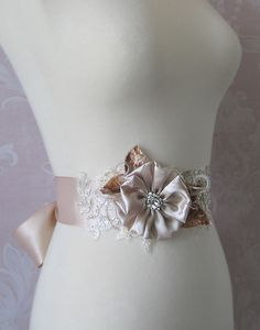 Champagne and Mocha Brown Bridal Sash, Wedding Belt, Rhinestone Bridal Sash with Feathers and Lace - TOFFEE. $80.00, via Etsy.